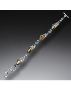 Handmade Silver Jeweled Fish Bracelet with Mammoth Ivory and Blue Topaz - Treasures from the Stream