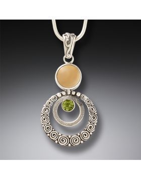 Handmade Silver Fossilized Walrus Ivory Pendant with Peridot - Ripples