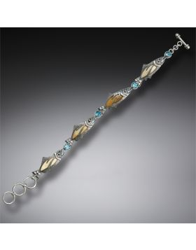 Handmade Silver Jeweled Fish Bracelet with Fossilized Walrus Ivory and Blue Topaz - Treasures from the Stream
