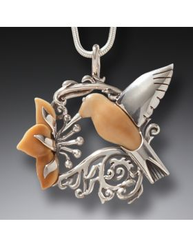 Fossilized ivory and silver hummingbird pendant