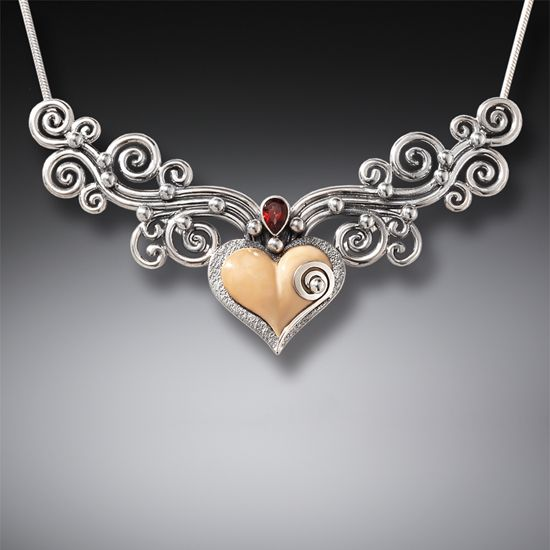 7ef4c74a8d Fossilized Walrus Ivory Heart Necklace with Sterling Silver and Garnet  Accent