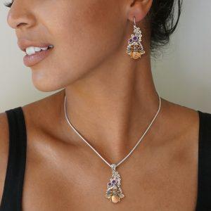Model wearing matching bee earrings & pendant